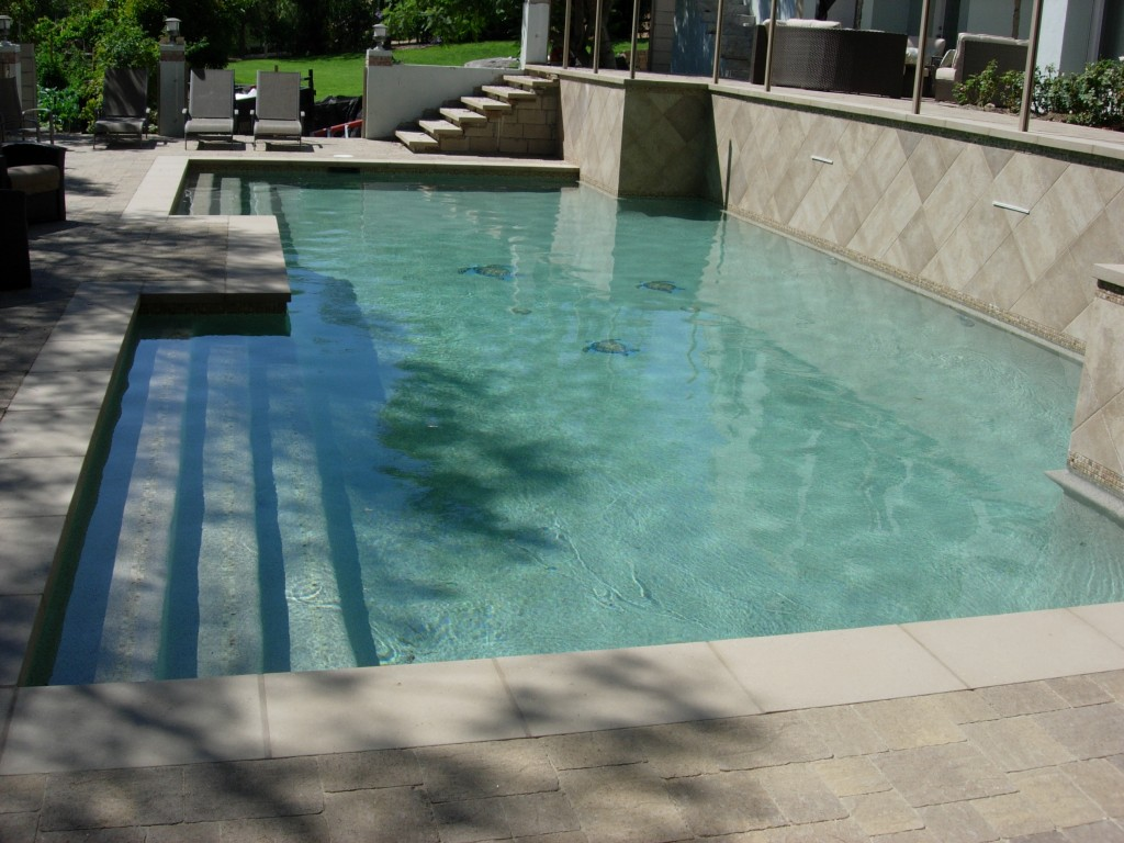 Sand pebble pool finish skinner pools for Pool plaster