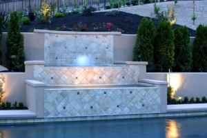 Adding a pool wall, water fall or other hardscape feature to your pool